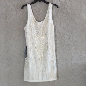 BEBE A bedazzled white dress from